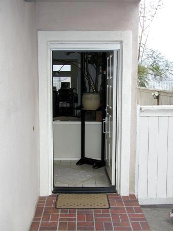 Hideaway doors hideaway tv cabinet in kitchen traditional for Hideaway screens retractable screens